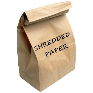 brown paper bags with shredded paper written on the outside of the bag