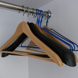 wooden, plastic and metal clothes hangers