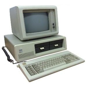 old computer, monitor, and keyboard