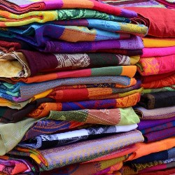 stacks of brightly colored folded pieces of fabric