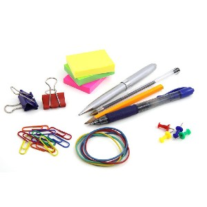 various office supplies such as paper clips, binder clips, sticky notes, pens, tacks, rubber bands