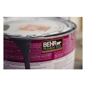 Behr premium plus paint can with a little bit of paint dripping out