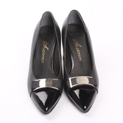 pair of womans shoes in the color black