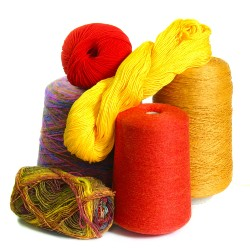 rolls and balls of orange, red and yellow yarn